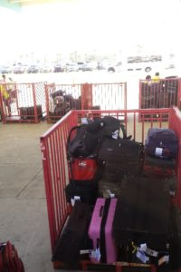 Look at how much luggage fits on that cart!